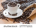 coffee beans in a coffee mug | Shutterstock . vector #177771311