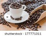 coffee beans in a coffee mug | Shutterstock . vector #177771311