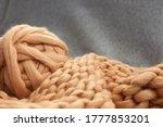 A Brown Beige Ball Of Woolen...