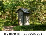 Old wooden toilet in the woods. ...