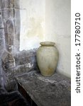 Earthenware Urn Standing On A...