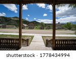 Scenic view from the hotel porch of the other abandoned, decaying buildings of Bannack Ghost Town in Montana