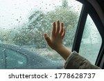 Child\'s Hand On The Window Pan...