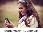 smiling young woman reading... | Shutterstock . vector #177886931