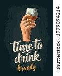 male hand holding glass brandy. ... | Shutterstock .eps vector #1779094214