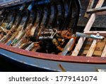 Rusty engine in an abandoned wooden boat - stock photo