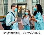 A Group Of Students Wearing...