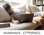 asian man sleeping while... | Shutterstock . vector #1779345611