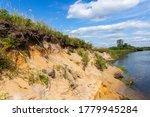 Steep Bank Of The River With...