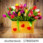 tulips in the box on wooden... | Shutterstock . vector #178003694