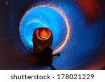 a worker works inside a pipe on ... | Shutterstock . vector #178021229