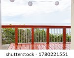 A Brown Wooden Terrace With A...