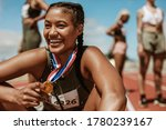 Female Runner With A Gold Medal ...