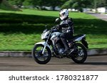 Small photo of campinas, sao paulo / brazil - july 31, 2013: motorcyclists are seen during test drive with motorcycles models CG Titan 150 EX from Honda manufacturer in the city of Campinas.
