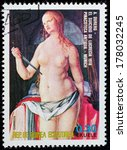 "Small photo of EQUATORIAL GUINEA - CIRCA 1974: A stamp printed in the Equatorial Guinea, shows a painted picture of Albrecht Durer ""Suicide of Lucretia"", circa 1974"