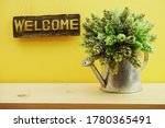 Welcome Sign Hanging On Yellow...