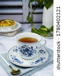 Small photo of A tea time with a snack is happy after hectic day. A close up, bright, shiny and blurry background