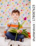 beautiful boy with tulips   Shutterstock . vector #178087625