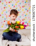 beautiful boy with tulips ... | Shutterstock . vector #178087721