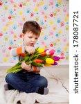 beautiful boy with tulips ...   Shutterstock . vector #178087721