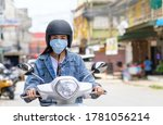 Woman Riding A Motorcycle...