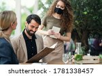 Waitress With Face Mask Serving ...