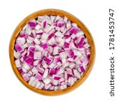 Small photo of Diced red onions in wooden bowl. Cut cubes of onion cultivar Allium cepa, with purplish red skin and white flesh tinged with red. Closeup, from above, on white background, isolated, macro food photo.