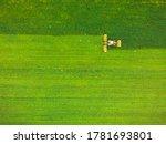 Tractor Mowing Green Field ...