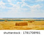 Straw Hay Bales On A Field....