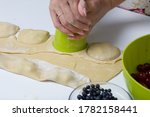 A Woman Forms Dumplings With A...