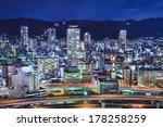Kobe, Japan city skyline viewed towards the Rokko Mountains. - stock photo