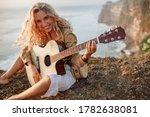 Beautiful Young Woman Playing...