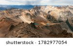 A stunning golden autumn view from the summit of Mount Sneffels of the Blue Lakes and a storm rolling over the distant peaks. Summit views, Blue Lakes, distant storm.  - stock photo