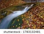 A River Flowing Between Rocks...