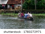 People using wooden small boat...