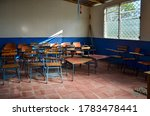 Inside A Classroom With Chairs...