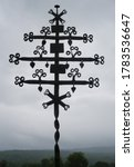 Ancient Iron Cross In Cemetery