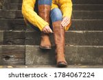 Woman Sitting On Stairs And...