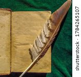 Opened Old Book And Feather On...