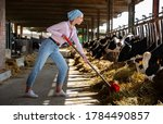 Young Female Farmer Working In...