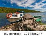 Small Oar Fishing Boat Moored...