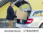 man invites box in the trunk of ... | Shutterstock . vector #178465895