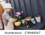 Elder Woman Wearing Sun Hat...