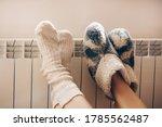 Small photo of Couple love. Legs with socks on heating radiator. Couple. Romantic lovers.