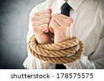 businessman with hands tied in... | Shutterstock . vector #178575575