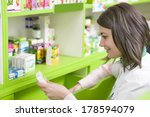 young female pharmacist in a... | Shutterstock . vector #178594079