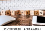 """Letters on wooden pieces concept, business background with the french word """"formation"""" means training"""