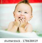 face of a smiling little baby... | Shutterstock . vector #178638419