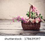 Flowers In Basket On Old...