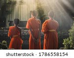 Small photo of three novices, Asian monks, happy novices, thai monk in Buddhist temple,Time to concentrate,The monks to pray respect to the Buddha, Thai culture, Thai Novice are prayer, praying